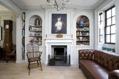 Contemporary English Style House Interior. Fireplace as the focal point of the living
