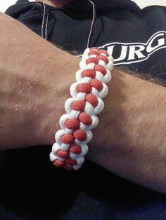 A survival bracelet with a baseball flair. Made with 550 paracord and a side release buckle. Great for any ball player or fan. Bracelet is made custom for each order. Baseball Gear, Baseball Season, Baseball Mom, Baseball Stuff, Football, Baseball Bracelet, No Crying In Baseball, Softball Crafts, Sport Craft