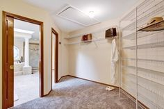 empty walk in closet. Large Empty Walk In Closet With Adjoining Bathroom