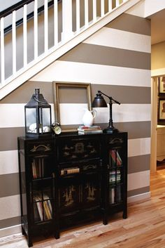 warm stripes in the entryway to lead people towards living room