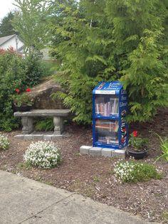 Little Free Library Sherrie Hansen. Bellingham, WA. - A fairly simple podium bookshelf with a plexi door