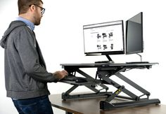 Enhance your workstation by finding the healthy balance between sitting and standing with DESK-V001A from VIVO! Designed to make your work experience more comfortable and ergonomic, you can transform your current desk space by adding this dual tier height adjustable workstation to the office. This product features a durable gas spring that provides smooth transition, a one-touch height lock mechanism, and a sturdy support structure #standingdesk