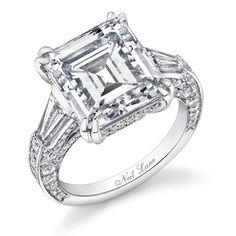 Emerald-cut diamond and platinum ring by Neil Lane