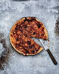 This over-the-top tart is a terrific mix of pungent Epoisses cheese, chopped ham and sweet apples.