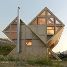 Plan Bureau imagines a twin-peaked wooden house in the mountains