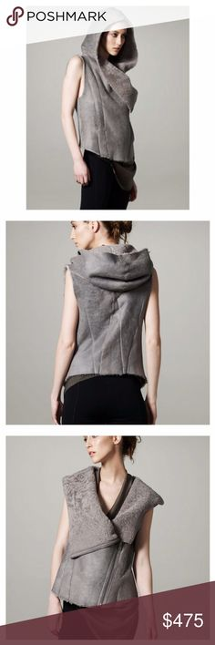 """Helmut Lang Weather Hood Shearling Vest The contrasting textures of shearling and leather redefine outerwear style.  Sleet (gray) distressed lambskin with gray dyed shearling (Italy) lining. Hooded back. Shawl collar flaps over. Sleeveless. Front zip on left side. Side seam pockets at high waist. Seamed details contour front; create """"Y"""" shape in back. Rounded hem on front. Worn just several times. Vest is in an excellent preowned condition. Helmut Lang Jackets & Coats Vests"""