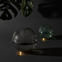 designstuff offers a range of Scandinavian home decor including this contemporary smoke black and brass globe vase by Danish brand AYTM. Shop online now!