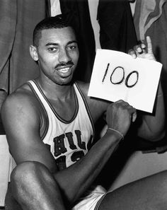 (1962) The Philadelphia Warriors' Wilt Chamberlain poses after being the first NBA player to score 100 points in a single game. I'm not sure if that record will ever be broken. #NBA