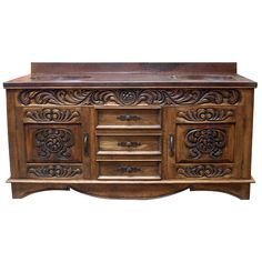 Spacious and elegant vanity design based on Spanish Colonial influences using the best quality Pinero wood. This great vanity is equipped, beneath its wide open customizable counter top, with three central spacious cock-beaded drawers, each with hand forged iron knobs, flanked by two cabinet doors with hand forged iron handles which open access to its spacious customizable inside. Inset top friezes around all sides are embellished through hand carved foliate colonial designs, as also occurs…
