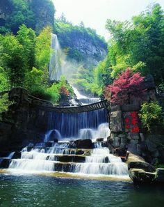 Have never been but this photo makes me love this waterfall! Waterfall Bridge, Zhangjiajie, China
