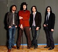 The Raconteurs - Promo Photo - Jack in Red    This is a promotional photo of The Raconteurs with an unusual wardrobe choice for Jack White. Usually not pictured in red garb other than in The White Stripes.    #3MR  www.3rdManRecords.com/?d=images  www.3rdManRecords.com/?d=images=display=177
