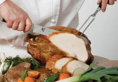 A carving knife is used to slice thin cuts of meat, including poultry, roasts, hams, and other large cooked meats.