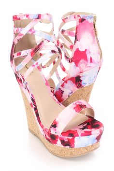 You will be head over heels for these saucy little numbers! They will perfectly compliment any outfit for any occasion! Make sure to add these to your collection, they definitely are a must have! The features for these wedges include a watercolor floral print fabric upper, strappy design, open toe, strap vamp, stitched trim, back ankle zipper closure, smooth lining, cork wedge heel detail, and cushioned footbed. Approximately 5.5 inch wedge heels and 1.75 inch platforms.