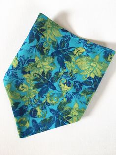 A personal favorite from my Etsy shop https://www.etsy.com/listing/385583788/blue-green-floral-dog-bandana-over