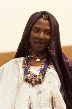 Africa |  Tuareg woman photographed in Goa, Mali.  Image Credit Georges Courreges. -- Pay attention to the use of Taureg Talhakimt pendants and zippers on blouse.
