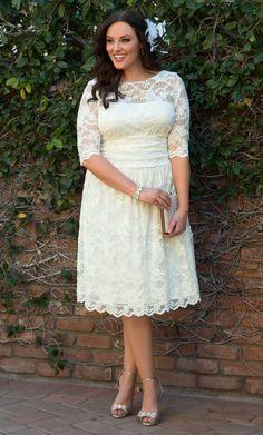 Add a vintage feather fascinator to our plus size Aurora Lace Wedding Dress on your special day. www.kiyonna.com #KiyonnaPlusYou #MadeintheUSA #Retro