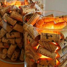 A candle within a hurricane lamp filled with wine corks! So simple and pretty