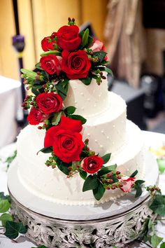 classic cake adorned with roses. Photo by Derrick Tribbey.