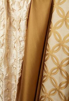 Rapture in Champagne (54871),  Poiret Satin in Tobacco (50443) and   Spherica in Champagne (2644264)  http://www.fschumacher.com/search/SearchResults.aspx?Cols=Modern%20Glamour%20|%20Wovens=ViewAll