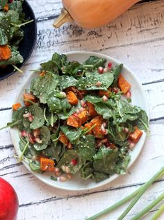 An easy and delicious Superfood Salad packed with pomegranate, sweet potato, hemp seeds, and creamy cinnamon orange dressing. Vegan and gluten-free!