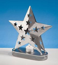Illuminate your tables with this Shimmering Star Centerpiece.  These metal centerpieces is 9 inches long x 3 inches wide x 9 3/4 inches high.