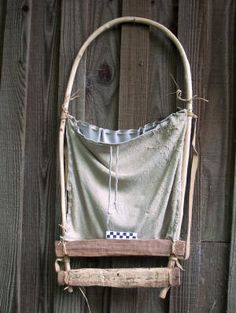 World's oldest rucksack - replica of mummified neolithic 'Otzi The Iceman's 5,000 year old backpack found preserved by ice high in the Alps. Hazel frame with larch wood supports and goat-hide basket (may have been woven grass rather than hide in the original).
