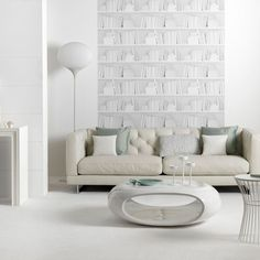 LIVING ROOM INSPIRATION | Neutral space with structural furniture choices that are both artistic and function | Evoking a calm yet sophisticated palate | Smaller furniture pieces are mobile and easily rearranged to allow for multi-use space |