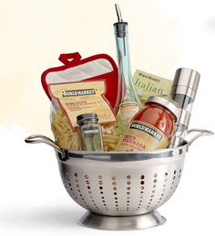 Do it Yourself Gift Basket Ideas for Any and All Occasions Pretty Food Gift Basket DIY - Use a Colander for a Foodie Gift via World Market - Do it Yourself Gift Baskets Ideas for All Occasions - Perfect for Christmas - Birthday or anytime! Food Gift Baskets, Themed Gift Baskets, Raffle Baskets, Basket Gift, Gift Basket Themes, Creative Gift Baskets, Theme Baskets, Kitchen Gift Baskets, Wedding Gift Baskets