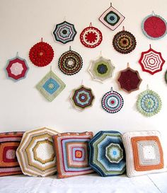 crocheted mandala potholders can not only used in the kitchen, but also hung on a wall. Great way to decorate the walls!