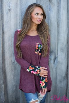 This sweet floral pocket blouse is sure to add a pop of colorful style to your fall wardrobe!