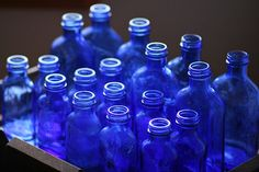blue bottles with sunflowers inside would be nice