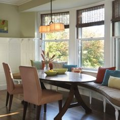 alluring-traditional-kitchen-with-classic-built-in-bench-seat-style-also-brown-padded-and-colorful-cusions-color-also-mahogany-wooden-round-dining-table-with-elegant-peach-dining-chair-also-lovely-pendant-lamp