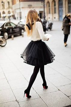 Louboutin high heels, black skirt and black nylons, white sweatshirt