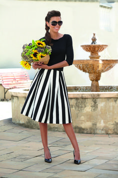 This outfit is fun and flirty, black and white striped skirt. Appropriate for over 40's too and a great midlife chic outfit.