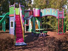 Colorful Castle-Love the bright colors, Rory likes the arched walk way with swings underneath and suspension bridge with roped sides.