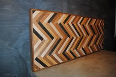 Herringbone Headboard, or HUGE Art Piece, or they make coffee table too - cool.