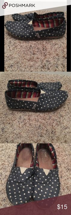Polka Dot Toms size 8. Good used shape These are in good used shape. The front of the shoe has some of the color rubbing off. It's not the shoe itself coming apart. These are navy colored. Price is firm Toms Shoes Flats & Loafers