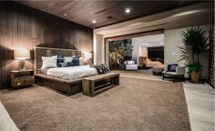 paneling from wall to ceiling, lighting & view through multiple rooms to large window