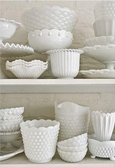 milk glass-display on open shelves in kitchen.