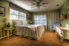 light green bedroom with many windows
