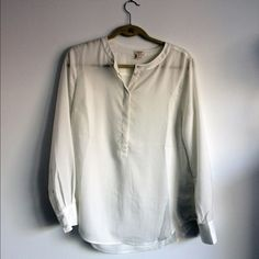 White Jcrew Factory Silk Top Long sleeve Jcrew Factory silk top. Size small, but I would say it fits more like a medium. Slightly see through, so it probably needs to be worn with some kind of shirt under it. Only worn once! Feel free to make an offer. J.Crew Factory Tops Blouses