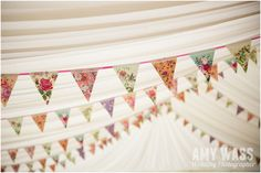 Vintage Floral Print bunting in a marquee  www.amywass.co.uk