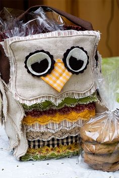 Check out this adorable owl lunch box project.  Instructions for embellishing a pre-made fabric bag can be found on this blog.