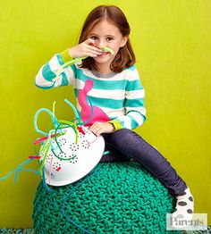 Set a colander upside down on the floor (or on an older kid's lap) and watch your child try to fill each hole with a colored pipe cleaner.