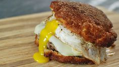 Fritter Breakfast Sandwich:   An over-the-top sausage and egg sandwich with an apple fritter as the bun!