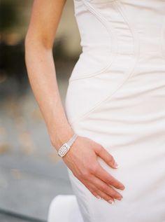 Oscar de la Renta gown and her grandmother's bracelet #bridalstyle