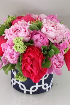 Pretty pinks and reds with a navy patterned  container - very modern