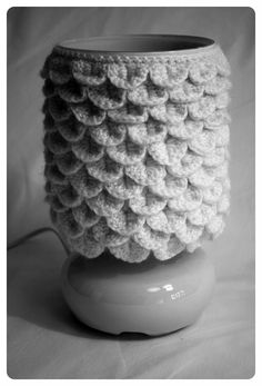 I have a lamp like this...I'd probably do something lacy but I never thought of crocheting around it before I saw this!