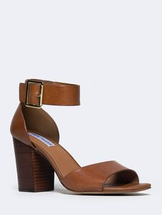 - Getting ready will be a breeze when you have these versatile ankle strap heels by your side! - Leather sandals have a wooden, block heel with an adjustable buckle closure on the side and an open toe