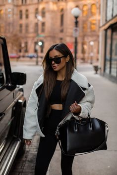 fashion blogger wearing a shearling jacket from Frame with a black workout set. #gymstyle #workout #casualoutfit #athleisure Cute Workout Outfits, Ribbed Knit Dress, Athleisure Outfits, Gym Style, Shearling Jacket, Weekend Wear, Crop Shirt, Lounge Wear, Personal Style
